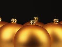 Big golden Christmas balls on black background. Stock Image
