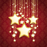 3 Big Golden Christmas Stars Red Ornaments. Christmas stars on thered background with ornaments Stock Image