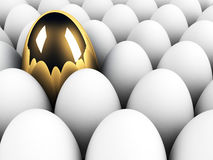 Big golden egg in the crowd Royalty Free Stock Photography