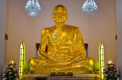 Big golden figure of Phra Mongkol Theb Muni (Luang Poh Wat Pak N Royalty Free Stock Images