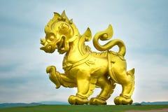Big golden lion statue stock photo