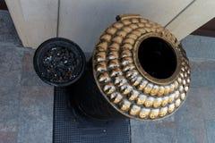 Big golden metalic ashtray Stock Photos