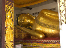The Big golden Reclining Buddha in the important temple Stock Images