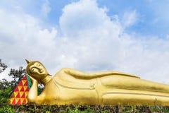 Big golden reclining buddha statue in thai temple Stock Image