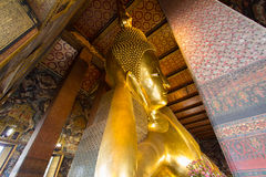 The Big golden Reclining Buddha within Wat Pho is the important Stock Photo