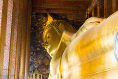 The Big golden Reclining Buddha within Wat Pho is the important Royalty Free Stock Photography