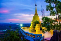 Big Golden Stupa on Tiger Cave Temple Mountain, Wat Tham Suea, Krabi, Thailand. Big Golden Stupa on Tiger Cave Temple Mountain, Wat Tham Suea, Krabi in Thailand stock photo