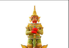 Big golden thai giant  statue stand  protection in thai temple isolated on white background Royalty Free Stock Image