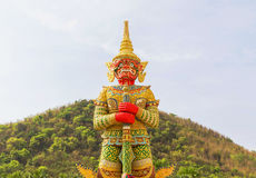 Big golden thai giant statue stand in thai temple Royalty Free Stock Photo