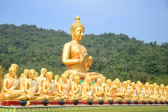 Big Golden and thousand of Golden Buddha statues Royalty Free Stock Photo