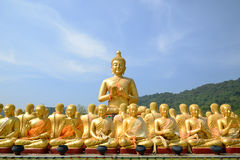 Big Golden and thousand of Golden Buddha statues Royalty Free Stock Image