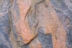 Big granite rock with nice patterns, big stone in the park.  Royalty Free Stock Photography