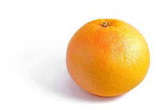 Big Grapefruit. Close-up photo of a big orange ripe grapefruit Stock Image