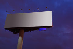 Big gray billboard at night Royalty Free Stock Photos