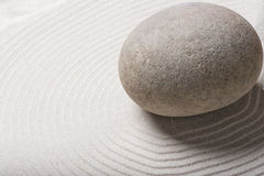 Big gray smooth stone. On sand Royalty Free Stock Photography