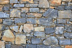 Big gray wall from stone bricks stock image