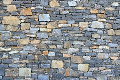 Big gray wall from stone bricks stock photo