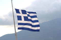 Big Greek Flag flying in the air at Acropolis Royalty Free Stock Image