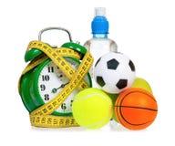 Big green alarm clock with small balls Royalty Free Stock Image