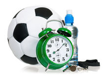 Big green alarm clock with soccer ball Stock Photography
