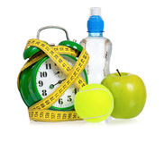 Big green alarm clock with tennis ball Royalty Free Stock Photography