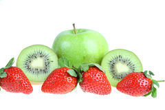 Big green apple , kiwi and strawberry. Stock Photo