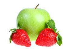 Big green apple and strawberry. Royalty Free Stock Photography