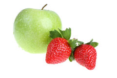 Big green apple and strawberry. Royalty Free Stock Image