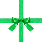 Big green bow knot on two crossing silk ribbons Stock Photo
