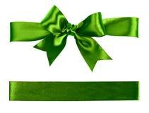 Big green bow made from silk. Ribbon Stock Photo