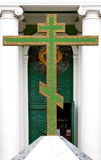Big green christian golden cross at entrance to temple Royalty Free Stock Photography