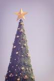 Big green christmas tree on blue sky Stock Images
