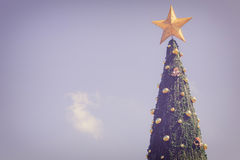 Big green christmas tree on blue sky Royalty Free Stock Photography