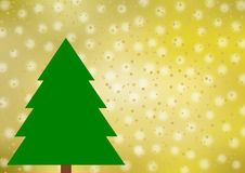 Big green fir tree on various shades of gold. Blurred snowflakes, golden stars and points, as well as with a large copy space on the right side Royalty Free Stock Photo
