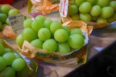 Big green grapes. Are placed on brown paper stock image