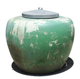 Big green jar with metal top cpver. Isolated on a white background Stock Image