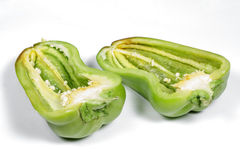 Big green pepper cut in half on white Royalty Free Stock Images