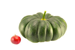 Big green pumpkin and small red apple isolated Stock Image