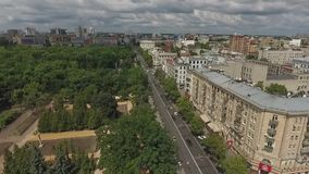 The big and green square in the centre of the modern city stock footage