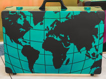 Big Green Suitcase, Travel Concept. Big Green Suitcase with Globe Cartography Print on it, Travel Concept Stock Image