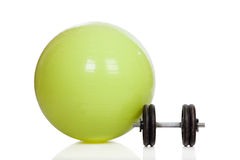 Big green training ball and dumbbell Royalty Free Stock Photography