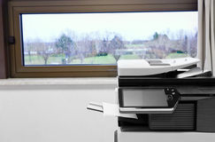 Big grey copier in grey office Stock Photo