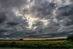 Big Grey Sky. The big grey clouds in the sky over the farmers fields royalty free stock photo