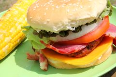 Big Grilled Bacon Cheese Burger in Summer Royalty Free Stock Photo
