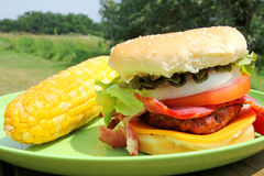 Big Grilled Bacon Cheese Burger in Summer Royalty Free Stock Photography