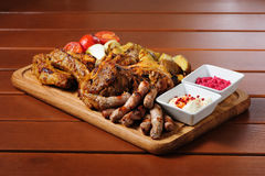 Big grilled meat and vegetables board Royalty Free Stock Images