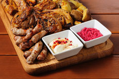 Big grilled meat and vegetables board Royalty Free Stock Photos