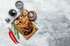 Big grilled pork steak with red wine. On a rustic background stock images