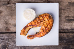 Big grilled salmon steak with rice on the plate Stock Images