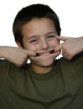 Big grin. Small boy clowning around while making silly monkey faces Royalty Free Stock Photos